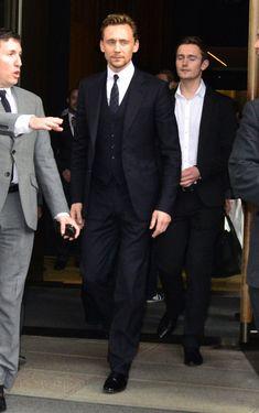 Oh. My. Gosh. The dapperness! - Tom Hiddleston Leaving The Trump Soho Hotel He's so taaaaalllll