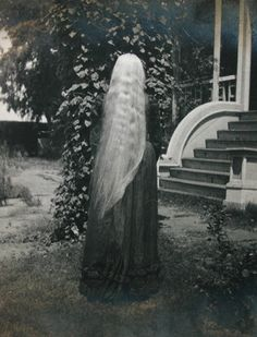 An almost ghostly image of Victorian woman's flowing locks. hair 1800s Victorian woman