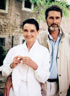 """Audrey Hepburn and Robert Wolders, 1980s. """"Sometimes, Audrey would become exasperated because Doris or somebody would say, 'What do you do all day?' We found that the day would fly by because the things we were involved with took a lot of time–the market, and so forth. You cook a meal carefully, hours go into that. For our own sake, but mostly for the dogs, we'd go to the lake and take our walks there. On a Sunday afternoon, if the weather allowed, we would have a swim, take some…"""