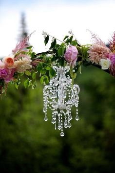Image via We Heart It https://weheartit.com/entry/150909243 #arch #chandelier #flowers