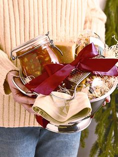 Here's another gift basket idea.  Prepare your favorite spaghetti sauce (I'm giving you the link to my all-time favorite marinara sauce) and ladle into a nice jar, include a package of pasta and a  chunk of parmigiana regigano cheese (or in my house, it probably will be more affordable pecorino romano), include a nice tea towel, and put all in a colander. Photo from Ladies Home Journal.   #HomemadeHoliday
