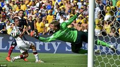 No way through: Germany keeper Manuel Neuer (right) pulls off an acrobatic save to keep ou...