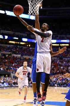 Russ Smith #2 of the Louisville Cardinals makes a layup against the Kentucky Wildcats during the regional semifinal of the 2014 NCAA Men's B...