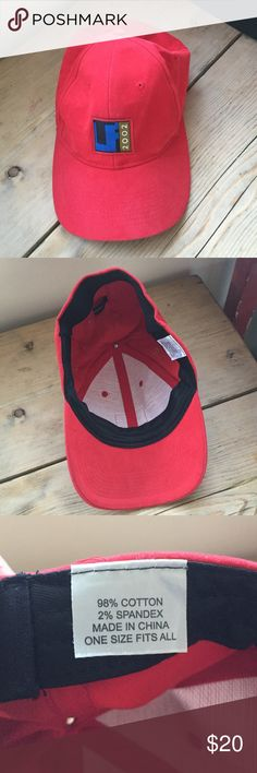 NWOT, red baseball cap, super soft, adjustable! I think I bought this hat at the Tribeca Film Festival in 2002. It's a super soft red baseball hat.  It is made of 98% cotton and 2% spandex. The spandex around the rim of the hat on the inside allows it to fit to any size head.  I never wore this hat. It is in excellent like new condition. Accessories Hats