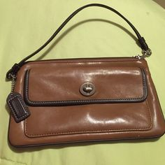 COACH CLUTCH COACH CLUTCH, IN PERFECT CONDITION, ZIPPER WORKS, HAS BUCKLE IN THE FRONT, PERFECT FOR DATE NIGHT Coach Bags Clutches & Wristlets