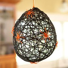 DIY spider web. Going to use white yarn and black spiders. It'll look like a hatching egg sac!