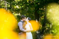 Wedding Portrait -Couple exchanging kiss in park located in Parry Sound