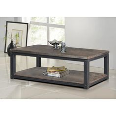 @Overstock.com - Heritage Coffee Table - This rustic coffee table features a metal frame with a weather wash grey wood top and bottom shelf. This handsome and sturdy accent table will add an intriguing accent to any space in your home.  http://www.overstock.com/Home-Garden/Heritage-Coffee-Table/7918353/product.html?CID=214117 $349.99