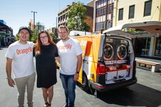Clean machine: Orange Sky Laundry founders Nic Marchesi and Lucas Patchett with  service manager, Joanne Mathews. Picture: Georgia Matts