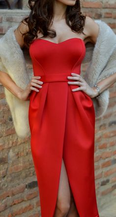 Red evening dress with faux fur shawl.