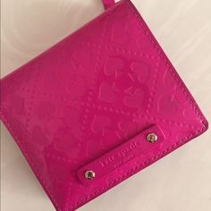 Kate Spade Wallet Hot pink with spade design. Patent leather. Authentic. See pictures for signs of wear. No holes, rips, or smell. kate spade Bags Wallets
