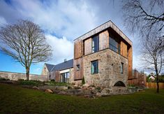 Incorporating the ruins of a former mill, the Bogbain Mill residence has been designed by Scottish studio Rural Design.