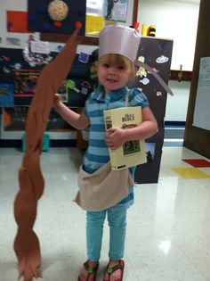 step two dress them in the Johnny Appleseed outfits(pan hat, stick, satchel for apple seeds, and then a bible to carry