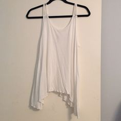 White tank top cute back Tank top with flowy backside worn once Bozzolo Tops Tank Tops