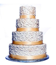 Four-Tiered Blush Colored cake with Scrollwork and Peach Ribbon