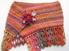 'Cherokee' crocheted wrap in ultra snuggly Passion yarn by James C. Brett.  The crocheted cotton brooch is detachable