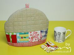 """Lovely Tea Cosy and Teabag pouch by Handmade by Mary Emmens   """"I quilted the tea cosy using #Aurifil 5006 50wt from my Pat Bravo Quilitng Heart box of threads, it went brilliantly with the aqua in the Sew Cherry fabrics and adds a lovely detail to the quilting.""""  find out more on http://mary.emmens.co.uk/2013/06/22/a-least-i-have-a-kettle/"""