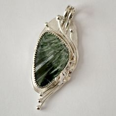 Seraphinite pendant.  Sterling silver bezel by Untwistedsister, $122.00
