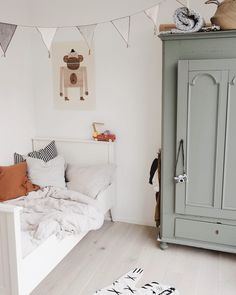 Modern farmhouse boy's room design featuring a green painted armoire, a white wood bed, woven illustrated animal rug, and gray and white banner garland - Unique Nursery Ideas & Children's Room Decor room ideas Decor Room, Bedroom Decor, Home Decor, Bedroom Ideas, Bedroom Lighting, Bedroom Curtains, Playroom Decor, Bedroom Colors, Kids Decor