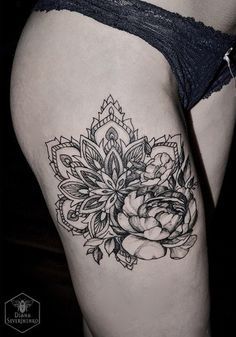 Mandala and flower thigh tattoo - Compact and beautiful black and white mandala tattoos. The tattoos tell a lot about the person's life, the pretty designs inside it are the explanation of how a person values his life.