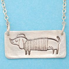 L'ARTISTE WIENER DOG silver necklace, illustrated by Gemma Correll, eco-friendly, handcrafted by Chocolate and Steel. $58.00, via Etsy.