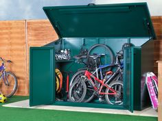 "Holds Up To 4 Adult Bikes  Height: 4ft 4"" (1340mm)  Width: 6ft 8"" (2060mm)   Depth: 3ft 4"" (1040mm)  Weight: 114kg (18 stone)  Door Aperture: 1060mm x 1360mm  Base Size: 7ft 1"" (2200mm) x 3ft 7"" (1150mm) This product needs approx 100mm clearance at the back (from a wall/fence) as the top sticks/swings out a little when the lid is lifted"