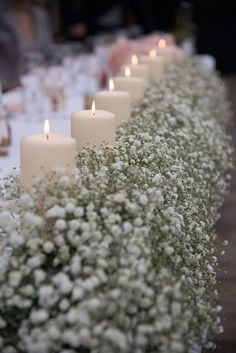 love this row of baby's breath and candles lining the wedding reception tables…cheap wedding decorations white candles surrounded by flowers gypsophila at the wedding reception laurence and ella Cheap Wedding Decorations Which Look Ch Cheap Wedding Decorations, Candle Wedding Centerpieces, Flower Centerpieces, Centerpiece Ideas, Wedding Ideas, Trendy Wedding, Chic Wedding, Cheap Flowers For Wedding, Wedding Centerpieces