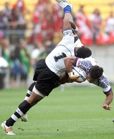 Afa Aiono of Samoa is tackled by Seremaia Burotu of Fiji ~Whenever Islands clash in Rugby...its always intense...and its fun