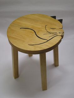 This little stool would make a simple bedside table too.   18 Ways To Subtly Cover Your Home In Cats