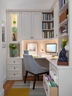 This home office neatly compiles a host of storage and detail into a cozy space. White corner desk features cabinetry reaching toward the ceiling, with a single grey Parson chair on multicolored rug at center.