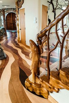 Unique: As well as their handsome base sculptures the staircases also feature tr. Unique: As well as their handsome base sculptures the staircases also feature tree branches which intertwine to form banisters, pictured Rustic Home Design, Wood Design, Stair Design, Design Table, Staircase Design, Banisters, Railings, Tree Sculpture, Ribbon Sculpture