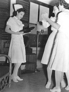 WW2 nurses in era uniforms
