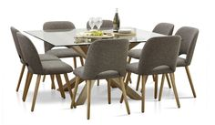 The Miles 1500 x 1500 glass top dining table is a new exciting spacious design which is supported by a chunky geometrical timber legs. With a scandi influence and 8 dining chairs, this is sure to be a centre piece of any living room