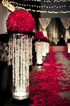 Something like this for the aisle with lights inside instead of crystals. Black feathers with a huge bouquet of flowers. Preferable flowers that are used in autumns bouquet. Maybe add a little green in them to match her bouquet and the daytime