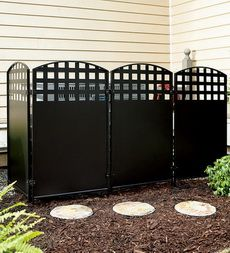 Black Metal Four-Panel Privacy Screen  A good idea to block the view of the garbage cans.