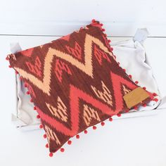 Pillow case square of ikat fabric zigzag design pillow in ORANGE, PINK and RUSTY brown with pompom trim 16x16""