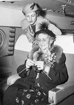 Mrs Elsie Meylan, 86 year old champion Red Cross knitter of California, gives Gertrude Husted of New York a few pointers. Mrs Meylan, who is making her first trans-atlantic flight, will visit her daughter in Lisbon, whome she has not seen for 30 years. The dexterous knitter spends many hours during the day working on socks and sweaters for veteran hospitals - 9 November 1950
