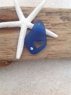 NEW-drilled heart  We have some beautiful new items. This is a sapphire blue freeform cultured sea glass pendant with a dainty carved heart and