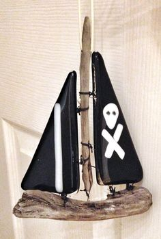 fused glass and driftwood pirate boat
