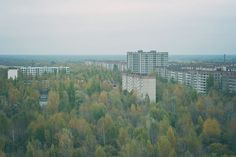 "'Pripyat High-Rise View' by James Charlick. ""Pripyat was the town built for the workers at the Chernobyl nuclear plant. It has been a ghost town since the accident. This photo was taken in the 16 storey building behind Fujiyama."""