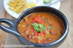 Frijoles Colombianos (Colombian-Style Beans)~ (6 SERVINGS) 3 cups cranberry or pinto beans ½ pound pork hocks 6 cups water 1 cup shredded carrots ½ teaspoon salt ½ green plantain, cuted into ¼- inch Guiso:  1 tablespoon chopped onions  2 cups diced tomatoes  ¼ cup chopped scallions  3 tablespoon vegetable oil  ¼ teaspoon salt  1 clove garlic, minced  ¼ cup chopped cilantro  ¼ teaspoon ground cumin Como Hacer Unos Frijoles, My Colombian Recipes, Colombian Food, Frijoles Colombianos, Columbian Recipes, Pork Hock, Beef Barley, Shredded Carrot, Best Comfort Food