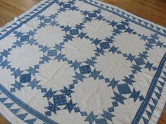 """Well loved 1880s indigo blue and white quilt with flying geese border, $145 on eBay. 67"""" x 70.5"""". Fraying on the binding; fabric wear around the border; some fabric wear throughout. Late 19th century. A very pretty quilt; thinking using it on sofa."""
