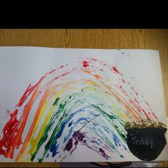 Very cute art activity for St. Patrick's Day that I did with my early childhood special education classroom. The rainbow was created by dipping toy cars in paint and driving them in the shape of a rainbow.