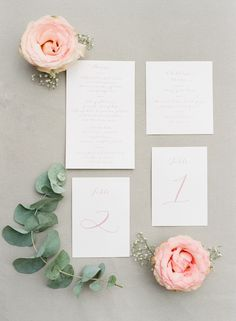 Elegant Pink and white wedding stationary flat lay with roses and eucalyptus