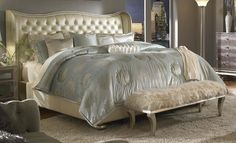 OMG I love this bed!  Creamy pearl leather tufted with crystals - it sounds like it would be tacky but it's really pretty.  Only $2499.99 at SavonFurniture.org