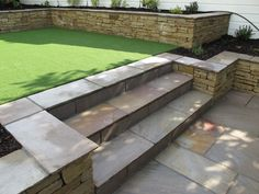 Split level low maintenance garden scheme with natural sandstone patios and raised planters. www.owenchubblandscapers.com we design - we build - we care