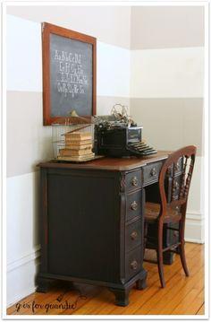 Vintage black desk and chalkboard.