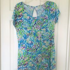 Lily Pulitzer T Shirt Dress Gorgeous Lily Pulitzer dress!!! We bought it online but it's just too big :( worn once (no tags) but still like new. It has a cute frocket and a little cutout in the back. Note: it runs a little big, and the material will stretch Lilly Pulitzer Dresses