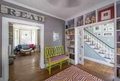 Joe and Alana's Newport Home Full of Bold Colors and Patterns House Tour: Color and Pattern in a Rhode Island House Small Vanity, Wall Bookshelves, Bedroom Flooring, Hallway Decorating, Furniture Layout, Eclectic Decor, Grey Walls, Bold Colors, 6 Years