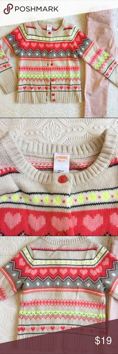 👫💕 Gymboree Sweater Button Down Heart Pattern Gymboree warm button down sweater with heart pattern for your little valentine! In gently used condition - no pilling or noticeable stains. Colors are cream, light pink, dark coral pink, gray, and yellow. Size is Small (5/6). Gymboree Shirts & Tops Sweaters